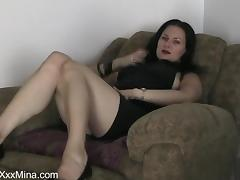 Mina Gorey moans with pleasure while rubbing her coochie with a dildo