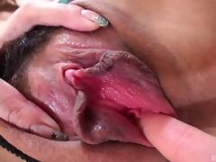 Seductress in a slutty dress seeks dick in her Japanese pussy