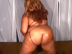 Dark large adorable woman woman with oiled up butt is shoving her slit with sex-toy