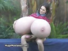 Brunette babe fucking her own giant tits part6