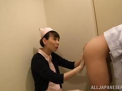 nippon lady in uniform handles patient