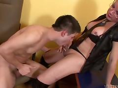 A guy gets fucked in the ass by his hung shemale boss