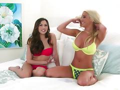 Giddy lesbian babes in sexy panties flaunt their big juggs