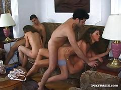 Twin babes take on three guys during a wild, hardcore orgy