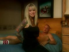 Blonde cougar with tattoo teases a cock before being drilled in a reality clip
