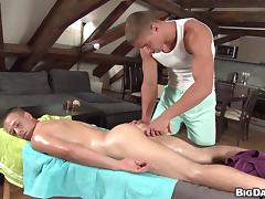 The masseur can't resist his sexy oiled up customer's cock