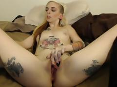 girl with tattoos and black nails plays with pussy