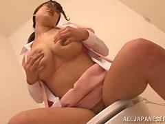 Japanese hottie fondles her huge melons in the toilet close up