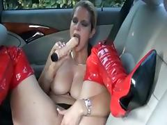 German slut fucks herself on the backseat porn tube video