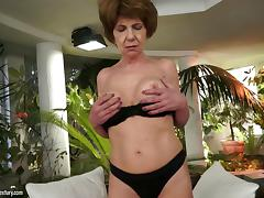 Granny dazzles in her stockings as she fucks a college guy