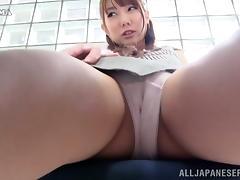 A hidden camera catches an upskirt on a Japanese office worker