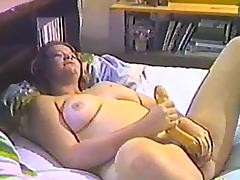 She feeds that long double dildo into her soaking wet pussy