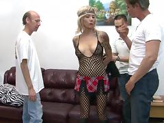 Mature hippie with ink serves three horny guys in a gangbang