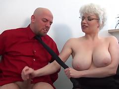 Brutal femdom handjob in office from busty MILF porn tube video