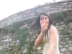 Luscious solo brunette Petra showing her feet outdoors