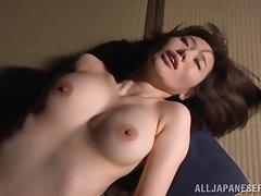 An older businessman eats a Japanese babe's hairy pussy