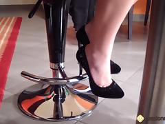 Italian solo model showing her feet in a bar for a foot fetish