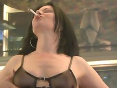 Curvy solo model brunette with natural tits in thong fingering her shaved pussy