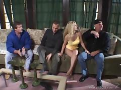 Blonde cougar with huge tits enjoying a hardcore gangbang