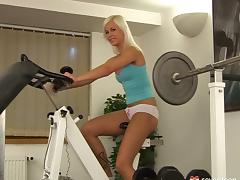 In her building's gym she works out then gets herself off tube porn video
