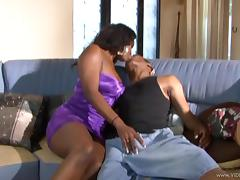 Curvy ebony with natural tits giving big black cock stunning titjob