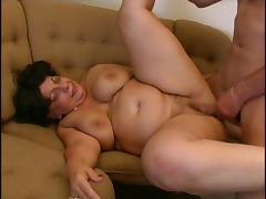 Seductive gilf fucked with a stiff prick on a couch