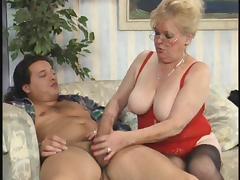 Blonde granny Elvira in hot lingerie sucks a cock and screws hard