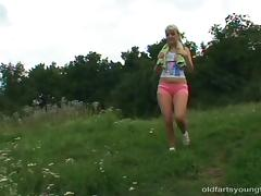 An old fart screws a delightful blonde teen outdoors