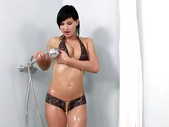 In the shower Abbie slips out of her pantie and washes her hot body