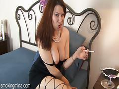 Smoking brunette model fingering her pussy in high heels