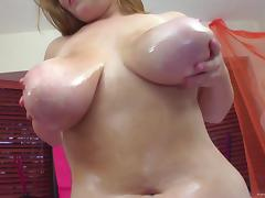 Breathtaking tattooed dame with oiled hot ass giving massive dick titjob