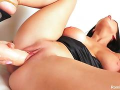 Sexy Romi stuffs her pussy with a large toy