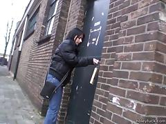 Sucking a cock through a glory hole after toying with her snatch