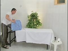 Face fucking and penetrating a mature slut on a massage table