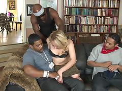 Curvy slut with a shaved pussy enjoying an interracial gangbang