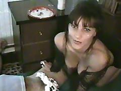 Amateur brunette wearing fishnets pleases her hubby with a handjob