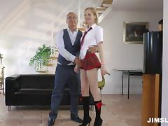 A cute coed in her uniform enjoys an older guy's cock