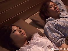 Wake up and play with the big titty Japanese chick in lingerie