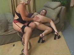 A mature lesbian and a younger babe grind pussies and lick nipples