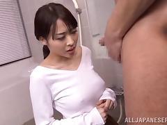 Japanese hottie sucks of an older dude in the bathroom