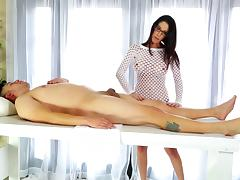 Dude gets a massage by a brunette hottie in glasses