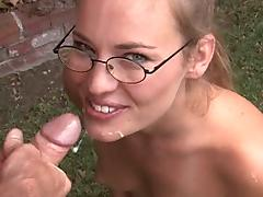 Blond babe in glasses suck dick outside and gets facial