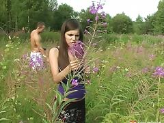 Romantic sex in a field of flowers with a cute brunette teen