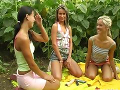 Chicks in sneakers fuck their big dildos on a farm tube porn video