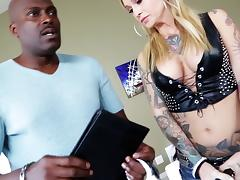 Tattooed blonde with awesome juggs sucking a huge black cock