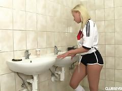 German sports lady sneaks to the toilet to quench her urge for a steamy masturbation tube porn video