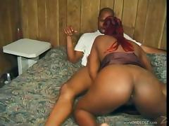 Attractive redhead ebony with nice black butt giving steamy blowjob before getting hammered doggystyle
