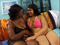 Thick lesbian bends over on the bed and gets pussy fingered by girlfriend