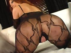 Immaculate redhead in enticing lingerie gets her shaved pussy hammered hardcore
