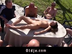 Small tit doll gang banged by older men in a reality shoot